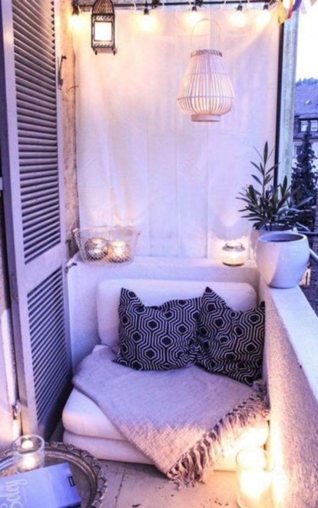 balcon cosy bougie fauteuil et coussin
