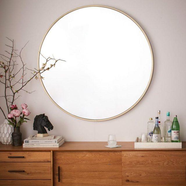 decoration miroir rond dessus meuble