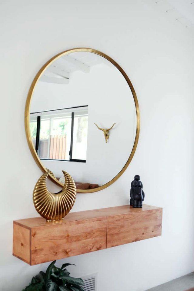 deco entree elegante feminine simple grand miroir rond console bois murale