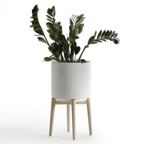 pot de fleur sur pied blanc