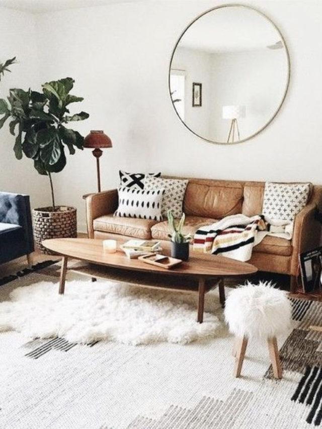 ou mettre miroir rond salon lumiere + canapé cuir moderne et chaleureux + tapis + plante
