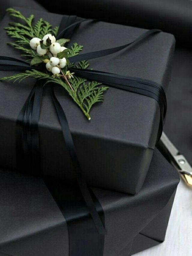 paquet cadeau elegant noir exemple et branche de cyprès