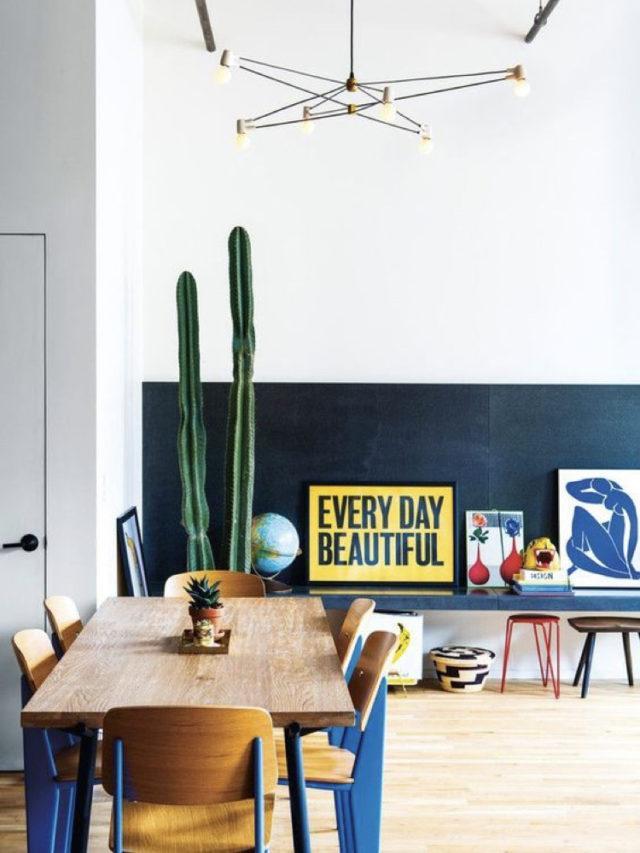 style arty decoration salle a manger soubassement noir cactus affiches déco encadrées table bois et chaise bois couleur