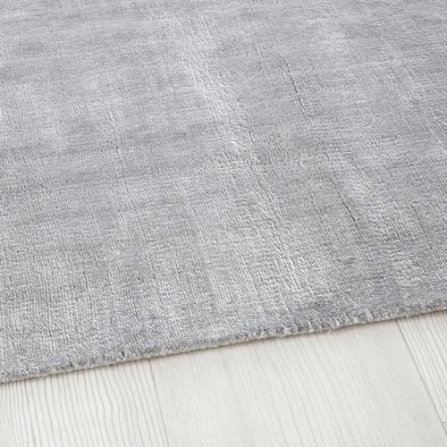 salon cosy tapis exemple poil court doux gris
