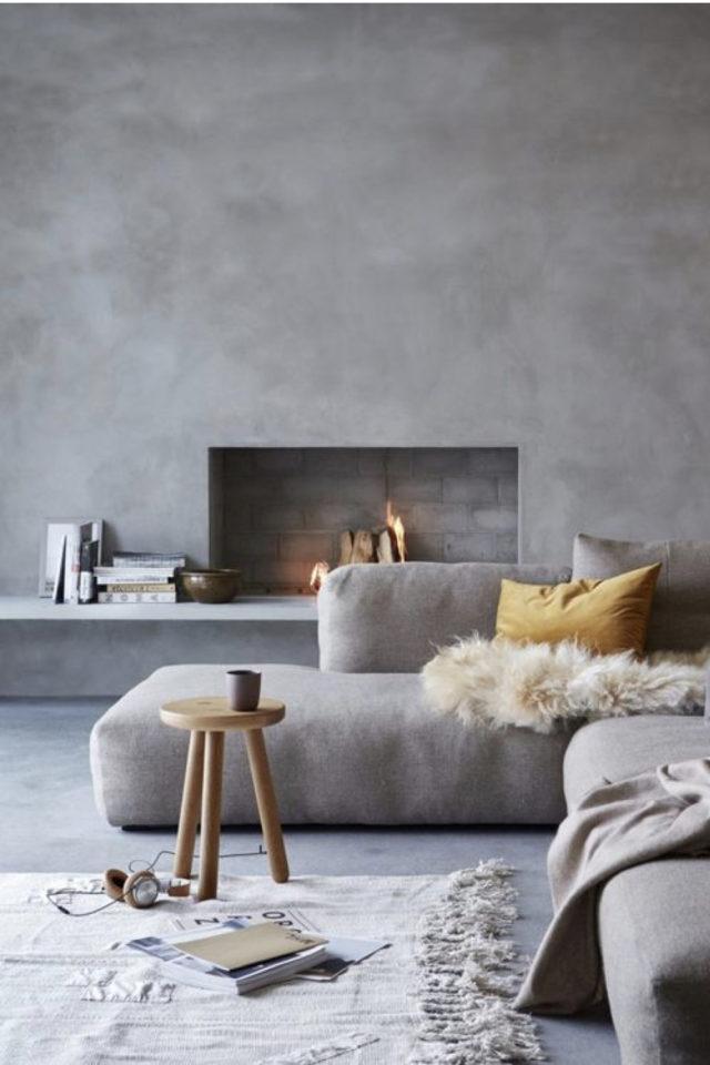 deco interieur couleur gris exemple béton ciré revêtement mural et cheminée moderne