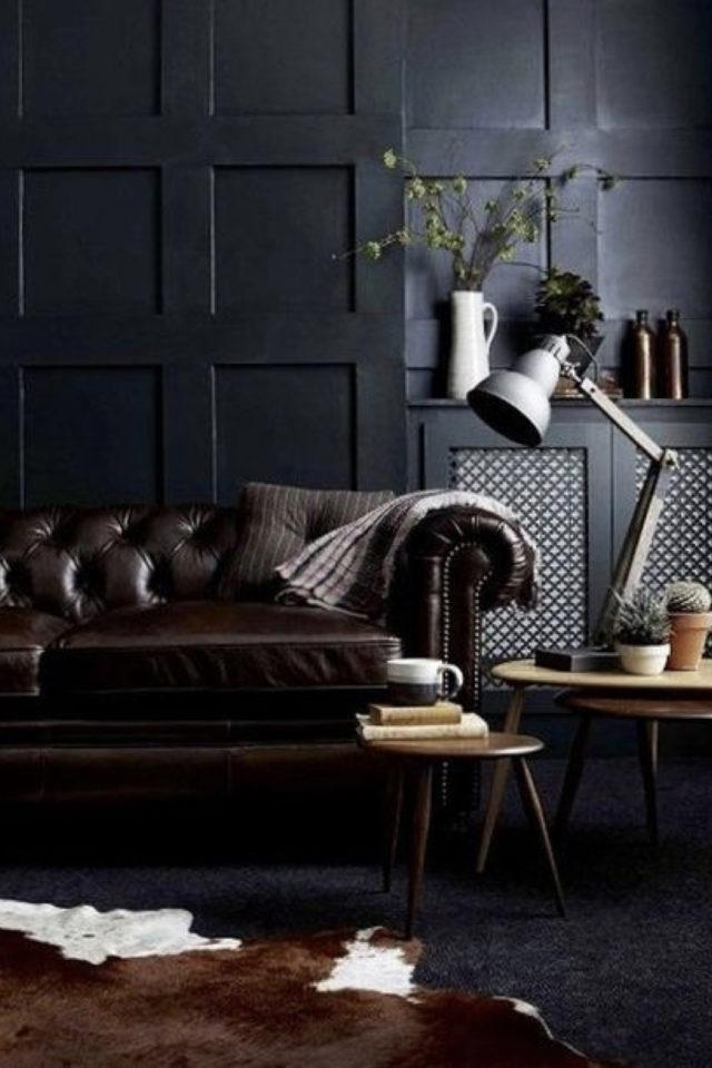 decoration interieure rock materiaux boiserie murale peinture canapé cuir capitonné ambiance élégante et vintage