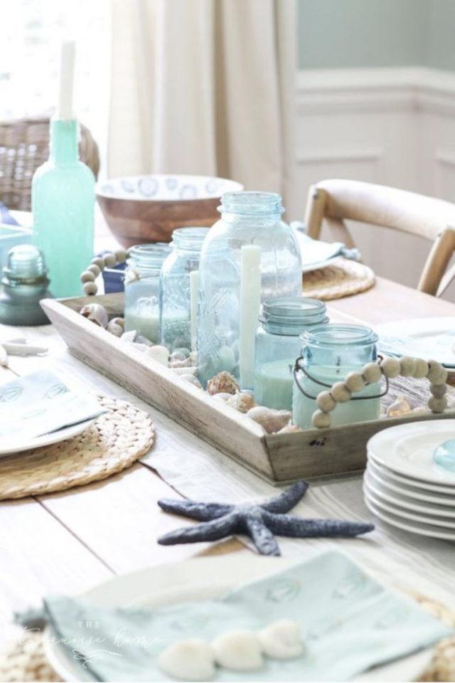 salle a manger style bord de mer exemple deco de table bocaux colorés étoile de mer set de table osier tressé