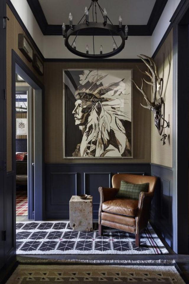 salon decoration style masculin exemple couleur sombre soubassement bleu et marron fauteuil cuir vieilli