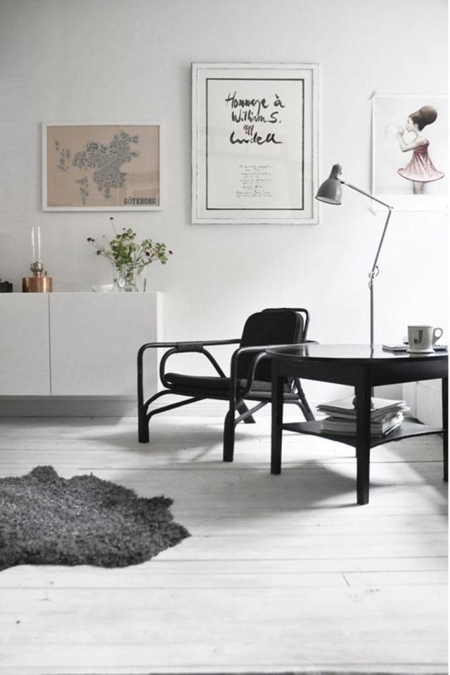 salon decoration style masculin exemple essentiel minimalisme blanc noir cuir liseuse