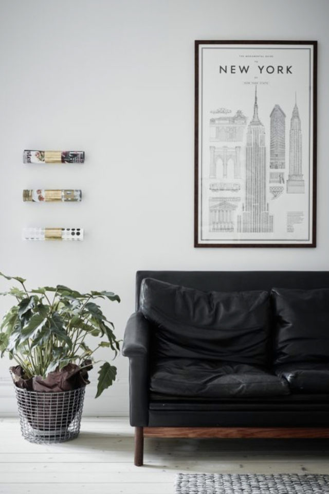 salon decoration style masculin exemple détail déco plante canapé cuir noir cadre mur illustration
