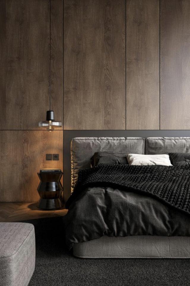 chambre a coucher style masculin exemple revêtement mural bois brut tête de lit tissus parure linge gris et noir