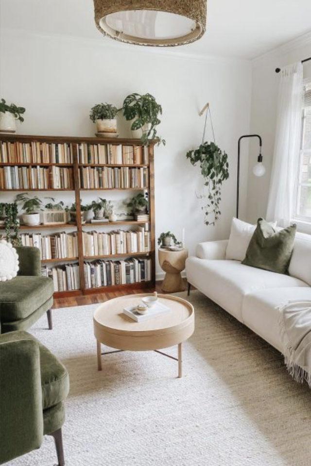 meuble salon style vintage exemple bibliothèque bois salon blanc canapé blanc fauteuil velours vert